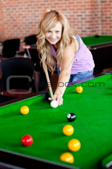 Bright woman playing pool