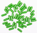 Green pills on white background