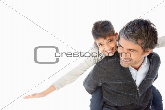 Father carrying happy son on back