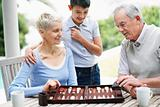 Senior man and woman play backgammon