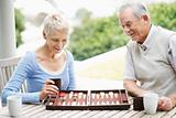 Man and woman enjoys a game of backgammon