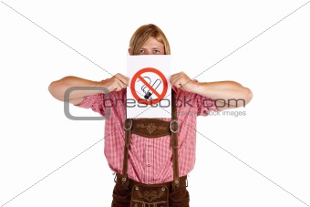 Bavarian man in lederhose holds no-smoking-rule sign in front of face