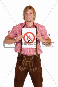 Smiling Bavarian man in lederhose holds non-smoking-rule sign