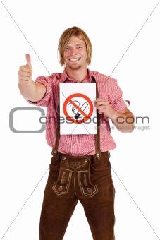 Smiling Bavarian man in lederhose agrees to non-smoking-rule