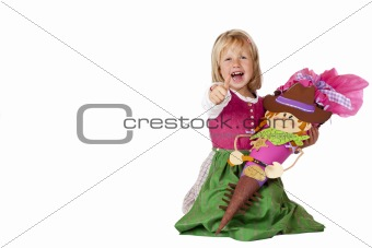 Happy bavarian girl sitting on first school day of floor, showing thumb up