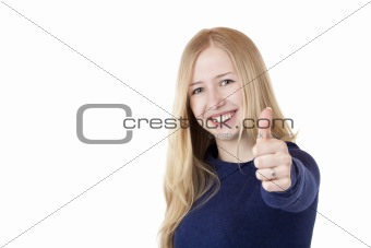 Young beautiful smiling woman shows thumb up