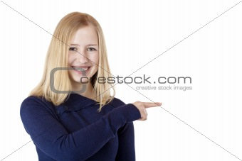 Young beautiful blond woman shows with finger on ad space