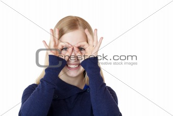 Young attractive woman shows with hands a binoculars