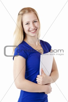 Young female student with writting pad smiles happy