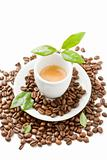 Espresso with green leaves on white background