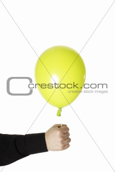 man holding yellow baloonn isolated