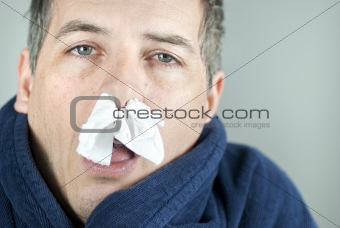 Man With Tissue In Nose