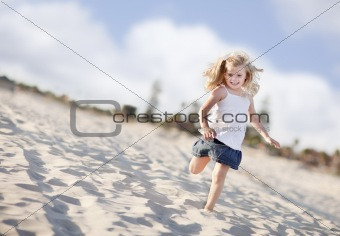 Adorable Little Girl Having Fun at the Beach One Sunny Afternoon.
