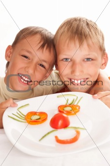 beautiful boys holding a plate