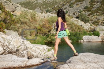woman walking on a Gredos river