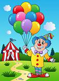 Clown with balloons near tent