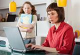 Mom and daughter with laptop