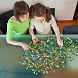 Girl and mom doing puzzle