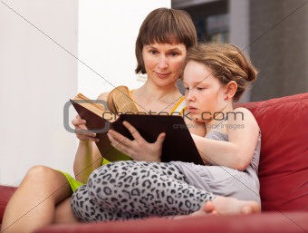 Girl and mom reading book
