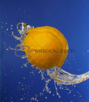 Splash in water with an orange