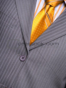 suit with a shirt and a tie