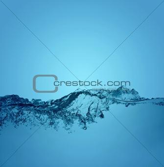 water splashing on blue