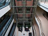 glass elevator shaft in a modern office building