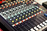 mixer buttons equipment in audio recording studio