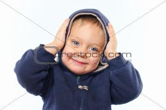 portrait of cute little boy in the hood
