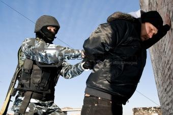 Soldier taking a criminal under arrest