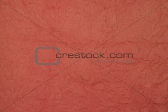 Background of Crumbled Paper a red color