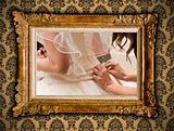 Wedding image in antique gilded frame on vintage damask style wa