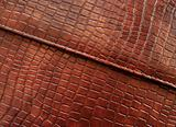 Leather with crocodile dressed texture.