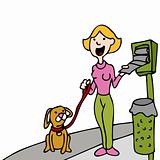 Using Pet Waste Bag Dispenser While Walking Dog