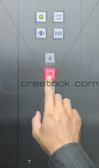 businessman hand press 3 floor in elevator