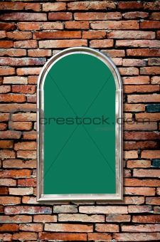 green board on old brick wall