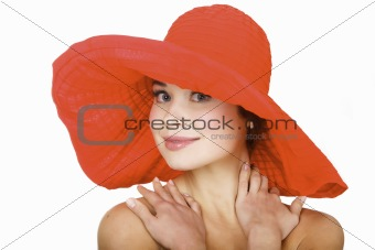 Beautiful woman wearing a hat, isolated on white background