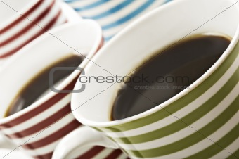 Close ups of mugs of black coffee