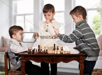 Twin brothers playing chess game