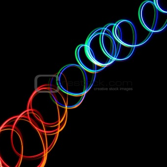 Chaotic colorful lights on a black background