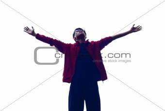 Backlit asian man outstretched arms
