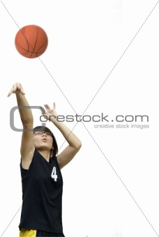 Asian chinese teen girl throw basketball on white