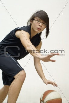 Fit asian basketball player defending ball