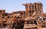 Used wooden pallets  stacked under open sky