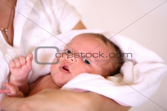 baby after bath in towel. soft focus