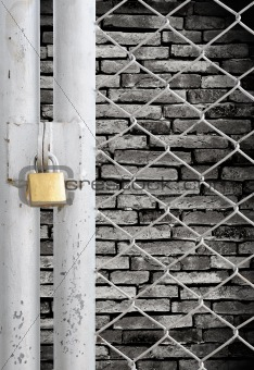 Chain link fence and metal door with lock see grunge wall background