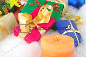 Lit Candle and Presents