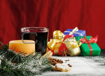 Lit Candle with Mulled Wine and Gifts