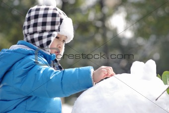 boy playing snow