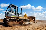 bulldozer with raised blade in action
